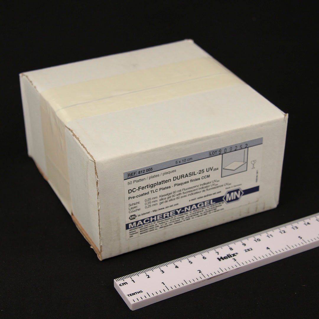Thin layer chromatography plates boxed and shown with scale rule