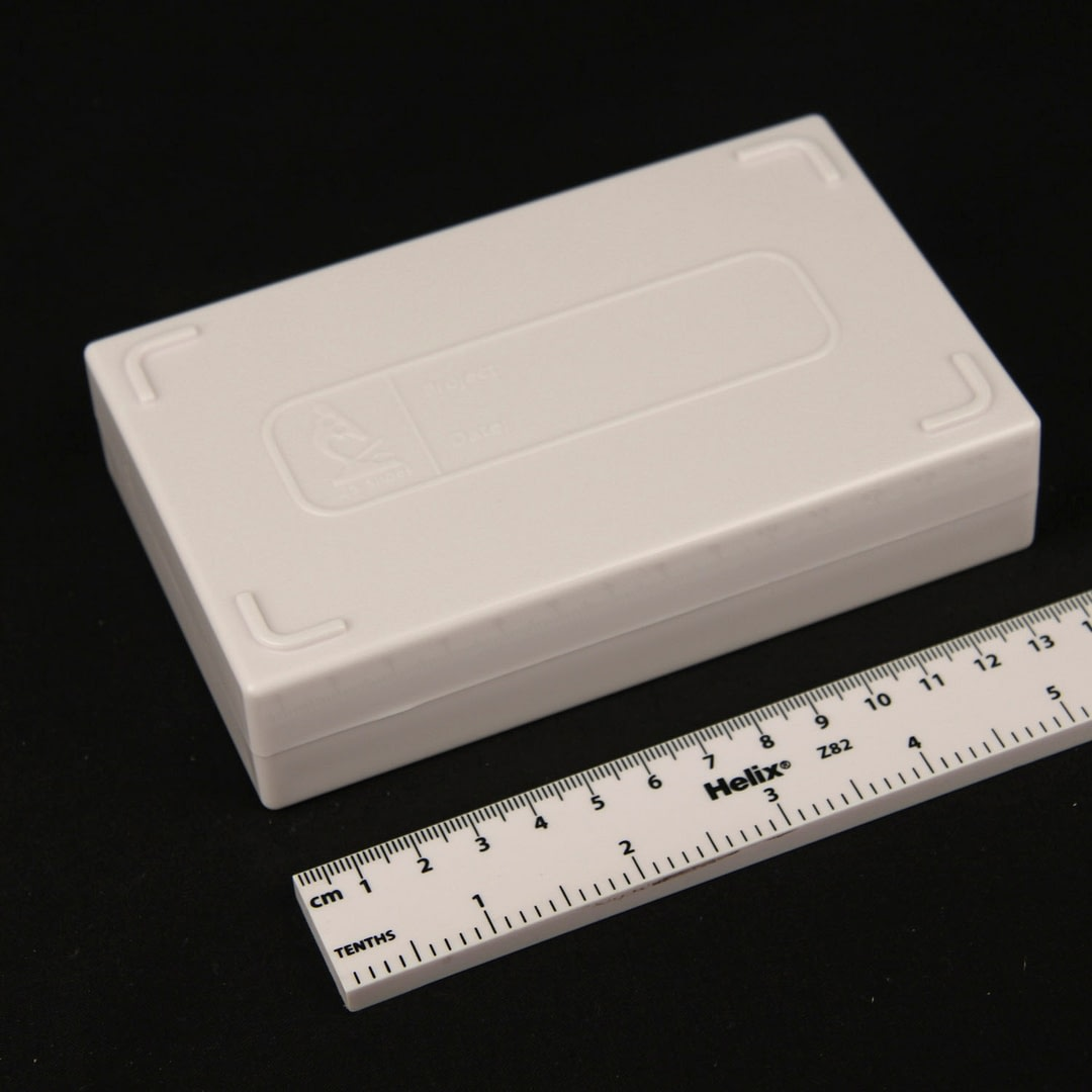Heavy duty slide storage box, 25 capacity (ABS) shown with scale rule SKU 25SCL